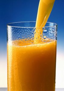 Public domain image of orange juice via Wikimedia Commons.